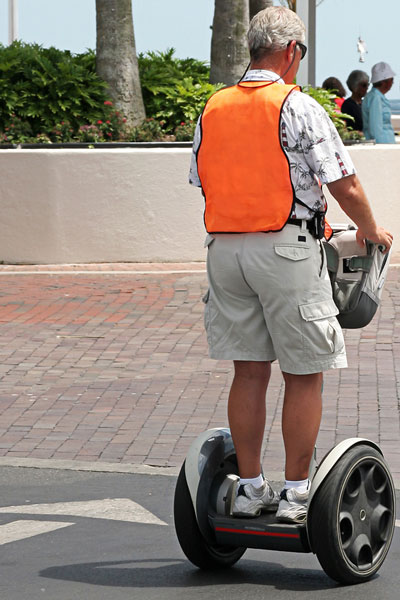a man rides a Segway electric scooter