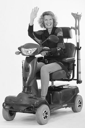 disabled woman riding an electric scooter